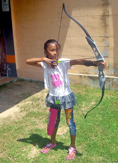 The diminutive archer was not fazed by using adult sized bows and arrows.