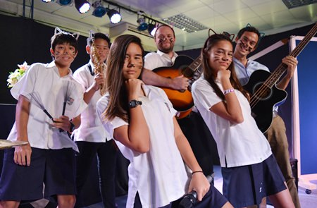 Students and teachers perform together.