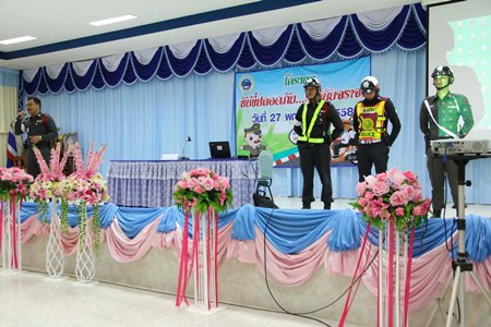 Sattahip traffic police sub-inspector, Pol. Capt. Wiroj Charitrum (left) and officers from the Sattahip traffic police, teach students about traffic law.