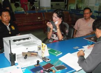 Nawin Maunsaiyad (center, on phone) has been arrested and charged with theft.