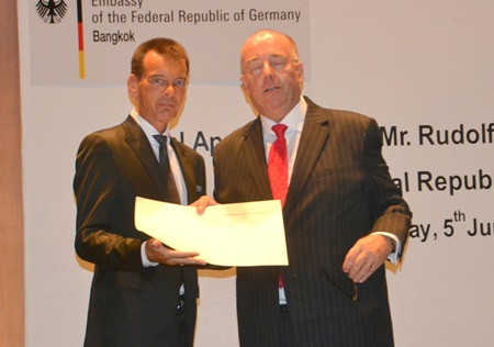German Ambassador H.E. Rolf Schulze gives Rudolf Hofer his credentials.