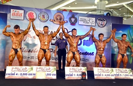 Thailand's Sudjai Janthalek (centre) celebrates winning the male over 75kg bodybuilding title at the RGP EX-Fever Muscle & Physique Contest held at the Royal Garden Plaza shopping mall in Pattaya, Saturday, May 30.