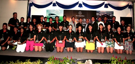 Trophy winners and VIPs pose for a group photograph at the conclusion of the Mercedes-Benz Junior Golf Asian Masters Final at Burapha Golf Resort, June 12, 2015.