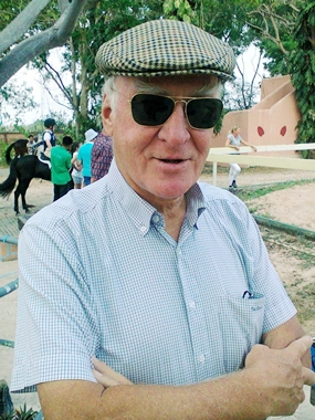 """Peter coaching his New Zealand imported horse """"Cash-in"""" at a Horseshoe Point Pattaya Competition in 2014."""