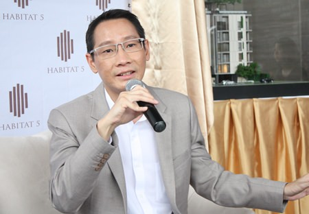 Chanin Vanijwongse, CEO of Habitat Five Co. Ltd., addresses the media at a press conference held Friday, July 17 to announce the new X2 Vibe Pattaya Seasphere condominium development.
