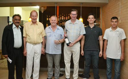 (L to R) Peter Malhotra, managing director of the Pattaya Mail Media Group, Helmut Zimmermann, general manager of the VN Garden Restaurant, Gudmund Eiksund, managing director of the Norwegian Properties Group, take a break from the fun to pose for a group photo with the men of the Aamlid family, Jan, Kevin and Matthew.