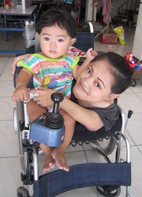 This is me with mom in our new wheelchair.