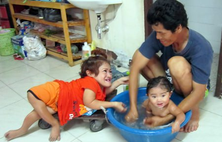 This is me getting a bath from my mom and dad.
