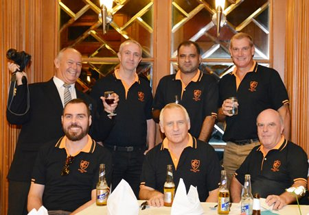 Rodney Charman (standing left) cheers on the Pattaya Cricket Club team led by Captain Simon Philbrook (standing right).