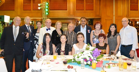 Distinguished guests included Rodney Charman (left) President of the Rotary Club Eastern Seaboard, Otmar and Margret Deter, Rotary E-Club Dolphin Pattaya International, Bernie Tuppin (standing centre) charity chair of the Jesters Care 4 Kids and Elfi Seitz (standing 3rd right).