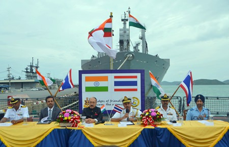 Visiting Indian naval officers and the Indian Ambassador to Thailand hold a press conference off the bow of the INS Satpura.
