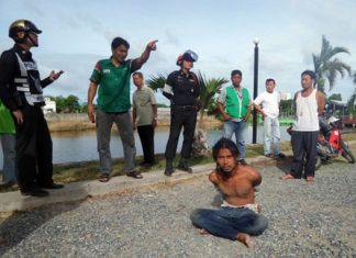 Neighbors restrained Rungroj Boongerd until police arrived, after he had tried to rape and rob a woman in Naklua.