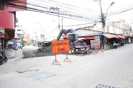 K-Sky Engineering workers begin digging up Soi Sophon Market to resurface it.