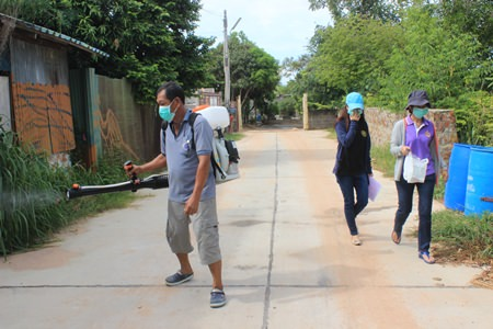 Staff from Nongprue Public Health Office sprays around the Khao Talo Community to help get rid of disease carrying mosquitoes.