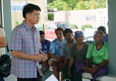 Songkran Saengjan from the Chonburi Provincial Fisheries Office meets with local fishermen to explain how to comply with Thailand's tightened trawler regulations.