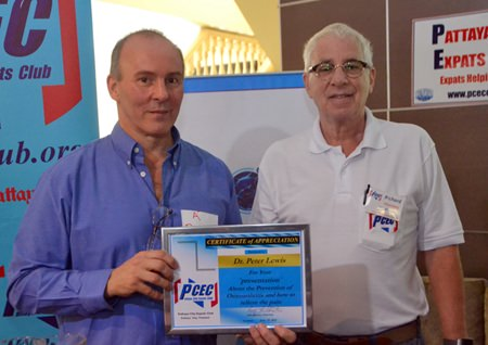 Master of Ceremonies Richard Silverberg provides Dr. Peter Lewis with the PCEC's Certificate of Appreciation for his talk about healthy living.