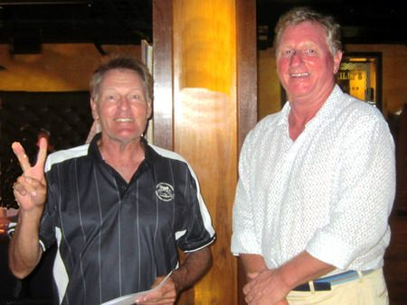 A Flight winner Steve Truelove (left) receives his prize from Maurice.