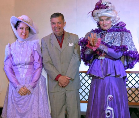 Paul Stachan as 'Earnest' (centre) poses with Mara Swankey playing Gwendoline and Alan Blackwood as Lady Bracknell, all characters in Oscar Wilde's 'The Importance of being Earnest'.
