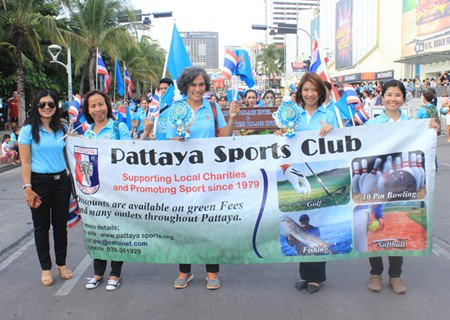 Pattaya Sports Club members proudly display their banner in the parade.
