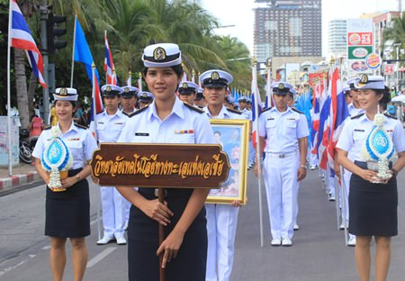 Students from Asia Technology University look smart as they march in their dress whites for the Mother's Day parade.