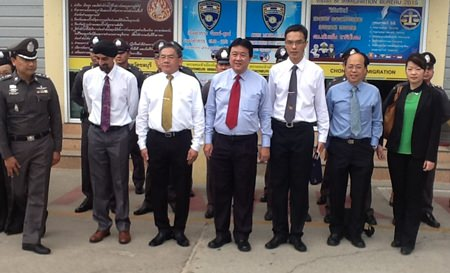 Singapore immigration police are given a tour of the Chonburi immigration offices in Jomtien.