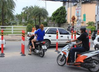 Barriers? Where? A fine example of motorists short cutting through the barriers and causing traffic jams.