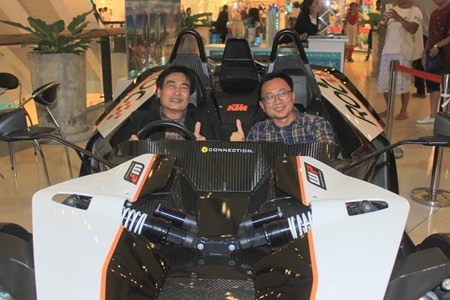 Deputy Mayor Ronakit Ekasingh (left) and PBTA president Sinchai Wattanasartsathorn sit inside the new KTM X-Bow ROC, the only one in Asia and one of only eight in the world.