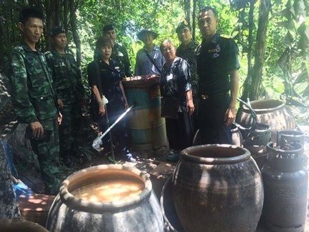 Government and military authorities raided three Huay Yai locations and seized 2,280 liters of illegal liquor, 70 percent alcohol by volume and scheduled to be used in herbal-spiced drinks.