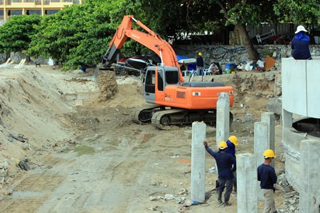 Construction staff from PSI Engineering work the drainage area near the Dusit curve in North Pattaya.