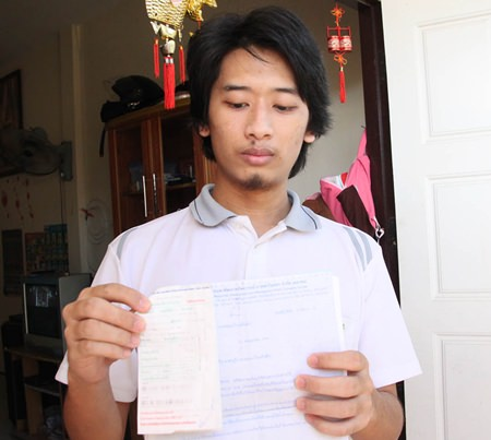 Yutapong Sirikanyalak shows the exorbitant water bills he received, adding up to 31,187 baht after only 2 months.