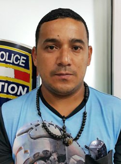 Cesar Augusto Caita Riomalo has been arrested for using a counterfeit passport with a fake name.