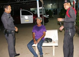 Allegedly in a drunken stupor, Udom Chanta (seated) told police he had murdered someone and wanted to turn himself in.