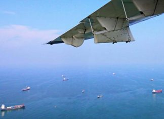 The Royal Thai Navy conducts an aerial search for missing crewmen from the Phataramarine 5, a containership that sank near the mouth of the Chao Phraya River.