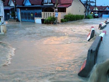 Cement barriers were no deterrent for runoff from a routine storm that hit East Pattaya's Eakmongkol Village 8 Sept. 10.
