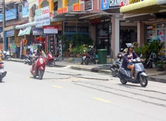 Residents need to be careful on Khao Talo Road, and avoid areas that look more like the surface of the moon than a street.