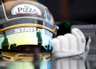 Thai driver Sandy Stuvik waits in his car on the grid prior to the start of Race 1 at Monza, Saturday, Sept. 5.