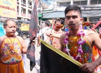 Devotees of the Kuan-Oo Shrine in Sattahip express their dedication to Chinese Taoist gods through blood in a display intended to demonstrate their gods' supernatural effect. During the annual Vegetarian Festival, these acts are performed as a way for Chinese-Thais to purify themselves through pain and complete abstinence from meat, sex and other vices.