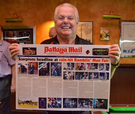 Kim Fletcher the landlord of Jameson's Irish pub with a souvenir poster of his recent trip to the Ramblin Man festival in the UK.