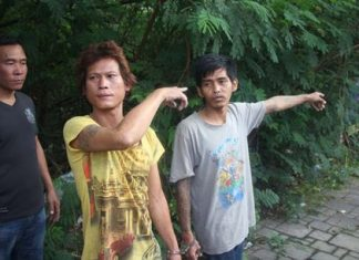 Sampao Hinart and Wittaya Saramul point to the area where they murdered Pongsak Polsriratch.