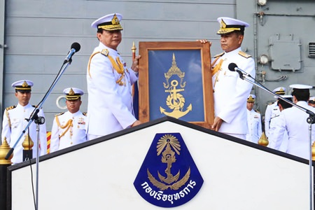 Retiring commander, Adm. Pijan Teeranet (left) passes over the command flag to successor Vice Adm. Narith Prathumsuwan (right) on the deck of the HTMS Naresuan aircraft carrier.