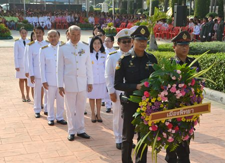 Local government officials, police, military and private citizens pay their respects to King Rama V on Chulalongkorn Day.