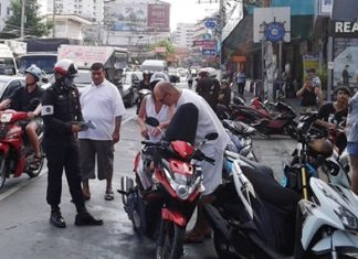 Police set up a checkpoint at the busy intersection of Second and South roads, checking for helmet use, licenses, and vehicle registrations, as well as for drugs or weapons.