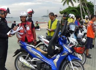 Chonburi transportation officials check for illegal motorbike taxi operators.