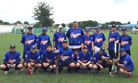 The Thai Tigers line up for a team photo.