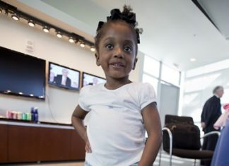 Miyah Williams, 3, holds her old prosthetic leg while showing off a new one in Washington, Friday, Oct. 23, 2015, during a meeting on the need for innovative pediatric medical devices hosted by Children's National Health System. (AP Photo/Manuel Balce Ceneta)