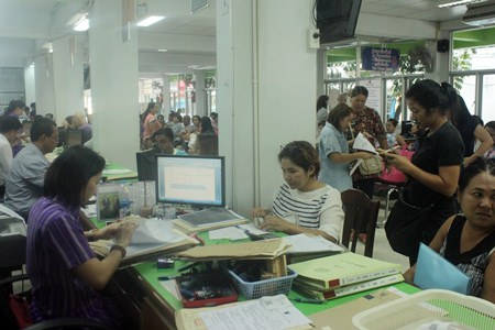 The Banglamung Land Office was packed on the first day that land title transfer fees were cut to nearly zero percent.