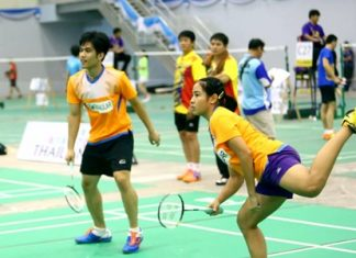 Badminton players compete on the opening day of the Astec Pattaya Badminton Sawasdee Cup 2015, Friday, November 13 at the Eastern National Indoor Sports Arena in Pattaya.