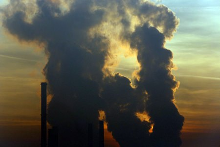 The sun sets behind a power plant powered by coal in the Bosnian town of Tuzla, 120 km north of Sarajevo, Bosnia, Saturday, Dec. 12, 2015. (AP Photo/Amel Emric)