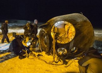 A search and rescue team works on the site of landing of the Soyuz TMA-17M capsule with the International Space Station crew near the town of Dzhezkazgan, Kazakhstan, Friday, Dec. 11, 2015. A three-person crew, U.S. space agency's Kjell Lindgren, Russia's Oleg Kononenko and Kimiya Yui of Japan, from the International Space Station landed safely Friday in the snowy steppes of Kazakhstan. (Andrey Shelepin/Pool Photo via AP)
