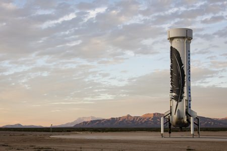 In this photo provided by Blue Origin taken on Monday, Nov. 23, 2015, an unmanned Blue Origin booster rocket sits after landing in Van Horn, West Texas. (Blue Origin via AP)